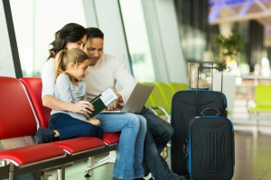 family using telehealth at airport